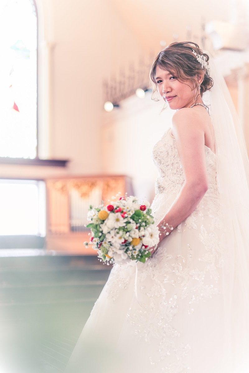 チャペルの雰囲気とピッタリな花嫁さん
